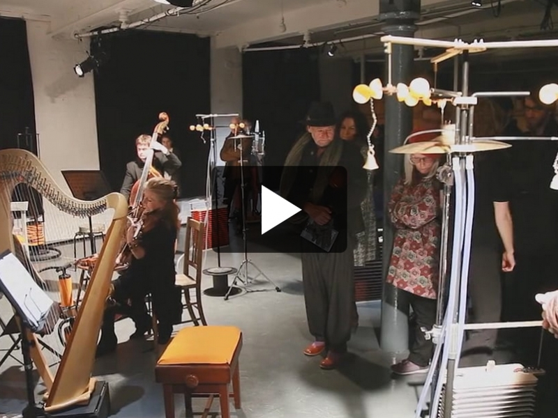 playing music with unusually created instruments.