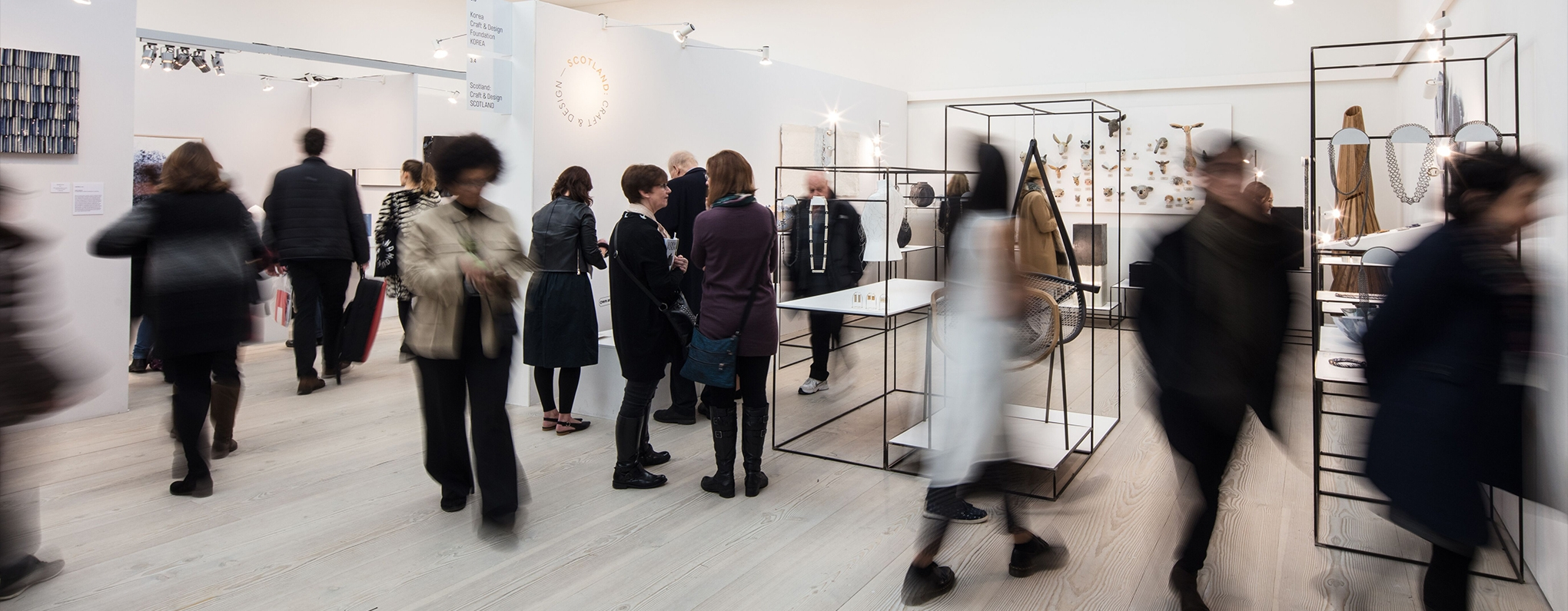 People viewing craft collection